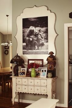 large black and white print mod podge onto wooden frame..makes a huge impact on any room I bet!!