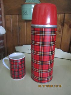 Aladdin Red Plaid Thermos Bottle with Matching Mug Perfect For Your Glamper or Camper by SewingforHope on Etsy https://www.etsy.com/listing/264507878/aladdin-red-plaid-thermos-bottle-with
