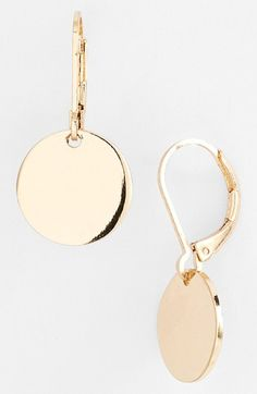 Any drop earrings with a snap or pop closure like these - in any metal (gold, silver, bronze, copper, mixed) and love beaded.     These are Nordstrom Disc Drop Earrings available at #Nordstrom