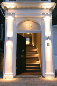 Lighting design by John Cullen Lighting Front Door Lighting, Entrance Lighting, Patio Lighting, Exterior Lighting, Lighting Design, House Lighting, Greek Revival Architecture, Light Architecture, Georgian Style Homes
