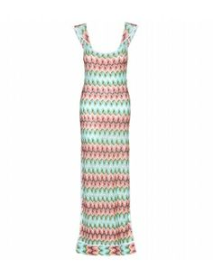 """When packing light, look no further than Missoni Mare's crochet-knit maxi dress. A fabulous choice for dining al fresco, simply slip it over your bikini to enjoy a pre-dinner cocktail."""