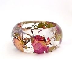 Handmade contemporary jewelry with resin and real flowers, made by former flower…