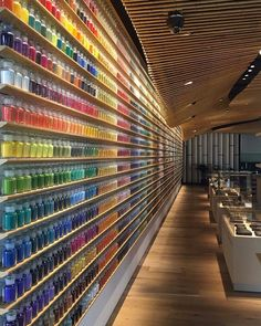 """Pigment is a new """"art supply laboratory"""" in #Tokyo by company @Warehouse_TERRADA. Designed with an open space concept by architect #KengoKuma the store features over 4000 (!!) pigments that are on display in glass vials beneath the store's wooden bamboo slats. \\\ Photo by @pro_gress by designmilk"""