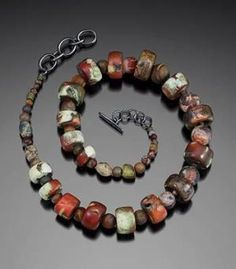Hidden Necklace by Jane Martin. Necklace in sterling silver, copper, brass, coral, jasper, and agate. 17-18 by rita