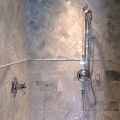 6x12 marble tile lower and 3x6 marble tile upper in herringbone patter with pencil tile detail