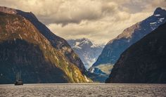 This is the entrance to Milford Sound from the Tasman Sea. It would have been so amazing to come across this and wonder what it was like up inside the fjord. And then, the captain could just decide to sail up inside and land some boats on the shore.  - Milford Sound, New Zealand - Photo from #treyratcliff Trey Ratcliff at http://www.StuckInCustoms.com