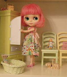 Blythe's pink bob perfectly compliments her domestic bliss.