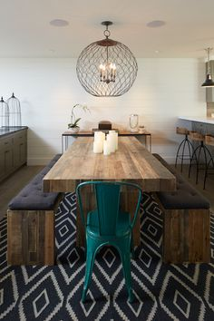 chandelier | Dining Room | rustic wood | colorful chair // Artistic Designs for Living - dining rooms - Simpatico Orb Four Light Small Chandelier, Arteriors Henson Wood Iron Swivel Stool, West Elm
