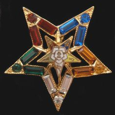 Order of the Eastern Star.  My Grandma was a life long member.  She died when she was 102 years old. Good people.
