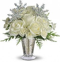 Winter Glow Bouquet T133-1A As enchanting as falling snowflakes, this dramatic yet graceful arrangement is a beautiful choice for an elegant evening celebration, winter ball centerpiece or to send silver anniversary wishes during the winter months. Lush white roses, miniature white carnations and fresh flat cedar branches are gathered in a stunning glass vase and decorated with silver snowflakes. https://www.4165flower.com/index.asp?pid=4=viewproduct=10154=1