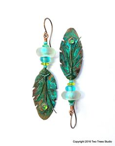 The Enchanted Forest: Featuring artisan-crafted colored copper feathers and luminous dichroic glass beads, these beautiful earrings are all luscious, rich color and bold, striking form.  By Two Trees Studio.