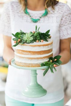 "Jenny treated her guests to homemade sweet treats, but she kept the decorating simple with a ""naked"" cake topped with beautiful succulents and lush greens."