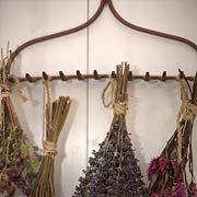 The tines of an old garden rake are good for hanging things like bundles of drying flowers.