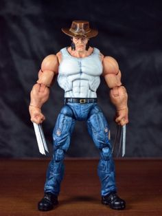 Logan (Marvel Legends) Custom Action Figure by Eddiegrayce's Custom Recipe: He was made from Conan figure,hulk arms,savage dragon crotch,capt legs,punisher head ,modified the crotch to fit into Capt leg