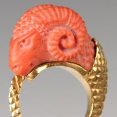 EGYPTIAN REVIVAL GOLD RING WITH CORAL RAM'S HEAD