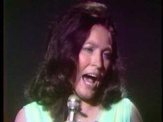 Loretta Lynn - Who Says God Is Dead.  This is on a wonderful gospel album.  Love Loretta!