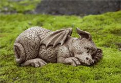 PUZZLE DRAGON GARDEN STATUE This little dragon garden ornament is cute and fun, a great way to add the power of myth and fantasy to your yard. Order this and other lawn dragon statues today. Free shipping.