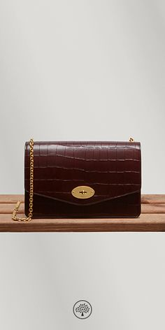 Shop the Darley in Oxblood Croc Leather at Mulberry.com. A classic clutch, iconic detailing and beautiful deep embossed croc print leather - a combination found in the Darley with its namesake lock closure, elegant detachable chain strap and organised interior in nappa lining.