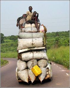 Overloaded - Africa- Photograph taken near Kinshasa, Democratic Republic of Congo. © Cedric Kalonji