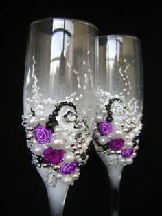 Gorgeous wedding champagne glasses, hand decorated with fabric roses and pearls, in purple, white, black and silver. $58.00, via Etsy.