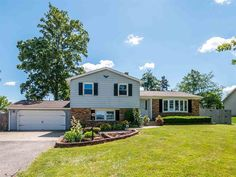 Spacious feel inside AND out. Screened porch overlooking your 1/2 acre privacy-fenced back yard with 25 x 14 stamped concrete patio! Nearly 2,000 square feet of living space, PLUS an unfinished, freshly waterproofed basement (with lifetime guarantee)!