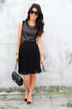 Black on black. Different textures. Pleated skirt, leather top.