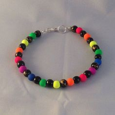 neon bracelet in a rainbow and black colour by BrowniesCRAFTBOX