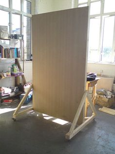 WALL ON WHEELS...could paint with the IF logo & polka dots, attach hooks, add a dry erase, bulletin board, magnetic board.