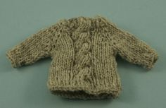 This pattern is a top-down raglan style sweater ornament. It's a great use for odds and ends of sock yarn. The pattern has basic instructions followed by a two-strand variation and a cabled variation.