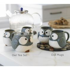 oh my, i really love these sweet little mugs. I can see it now, me 4 friends and hot tea or coffee on the backporch during fall :)