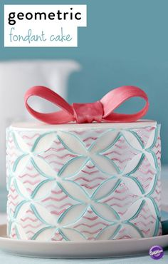 Decorated with a geometric pattern and a pretty bow topper, this cake's pastel palette creates a delightful centerpiece for a Mother's Day celebration.