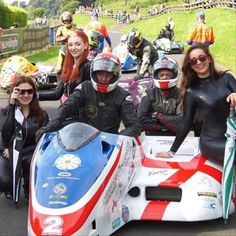 With Isle of Man TT winners, Harrison and Bell. Sunday race weather was glorious 🌄 #IsleOfMan #Winners #Harrison #Bell #Sidecar #moneyteam #promo #RaceDay #startline #OnTheGrid #OliversMount #GridGirl #CockOfTheNorth #brollydollys #BrollyDolly #promogirls #GridTeam #OliversMountCircuit #VFracing #VFgridGirls #catsuit #Spandex