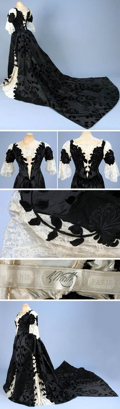 Evening dress with court train, Worth, ca. 1898. Two-piece black silk velvet voided to satin. Boned back-lacing bodice cut along velvet floral & inset at shoulder. Front & back with cream Alençon lace over chiffon with spangles, short sleeve with lace ruffle, matching skirt with 3 front lace gores over pleated chiffon and long, square train. Silk lining. Whitaker Auctions