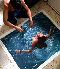 Gustavo Silva Nunez is a new kind of Artist making huge splashes with his work. His hyperrealistic paintings jump out at the viewer and make you question if what is in front of you is real or not. He creates images of people swimming, floating and splashing around in water and the end results are always absolutely stunning. It might be hard to wrap your mind around his work, but it sure is fun to try!
