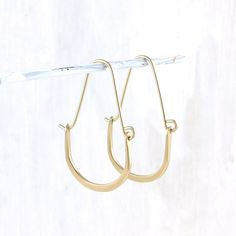 Fail Jewelry's 14k gold-fill earrings are aptly named—how could we not encounter good fortune when wearing these gorgeous hoops?