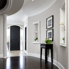 grey walls, dark floors, white molding, black door