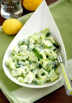 3-4 cucumbers  2 green onions  ½ cup mint leaves    For the dressing:  ¼ cup yogurt / thick /  1 clove garlic  2 tablespoons lemon juice  2 teaspoons water  1 teaspoon grated lemon peel    Mix in a salad bowl cucumber, onion and mint, cover with plastic wrap, and store in refrigerator to cool.  Mix yogurt, garlic, lemon juice, water, lemon rind. Try / test / need for salt or pepper. Chill the dressing for 20 minutes. Pour over salad and serve immediately