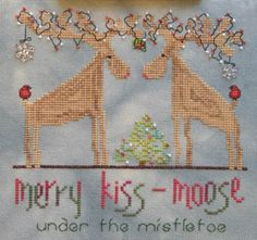 Under The Mistletoe is the title of this cross stitch pattern from MarNic Designs.