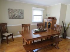 Traditional Dining Room With High Ceiling, Chair Rail, Hardwood Floors,  Crown Molding,