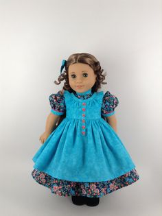 Handmade prairie dress and pinafore for American Girl and other similar 18-inch dolls. This sweet prairie dress, with peach, tangerine, and aqua