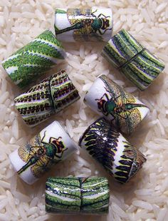 Handmade Paper Beads Ferns and Dragonflies  Tube Style by deeann7, $6.00 This is the last week to enter the drawing for a free set of my beads. Re post this pin, follow me on Twitter, or like my FB page to be entered for a chance to win.