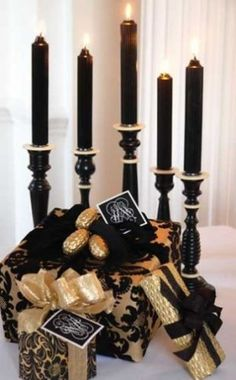 Elegant black and gold tea party.Black and gold, gifts, black candles, Carolyne Roehm Black Christmas, Christmas Colors, Christmas Holidays, Christmas Gifts, Elegant Christmas, Halloween Christmas, Gold Christmas Decorations, Holiday Decor, Holiday Style