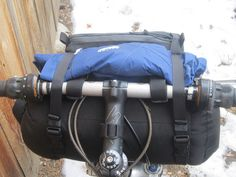 carrier with rain gear - rear by Bolder Bikepacking Gear, via Flickr