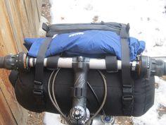 carrier with rain gear - rear by Bolder Bikepacking Gear, via Flickr