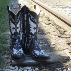These stunning black Domino cowboy boots from Bodacious Boots Co. will make you feel like you're walking on clouds. There's a country girl in all of us, no matter where you're from, and these boots are sure to bring out that side. Buy online at http://www.thepeacocklane.com/product-p/bodacious-domino-boots.htm