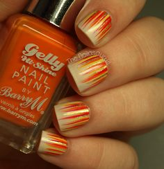 I think this is pretty!! They should call it Tequila Sunrise!  Firey waterfall mani via The Nailasaurus