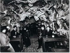 Interior of Le Café de L'Enfer in Paris, one of the world's first theme restaurants. The cafe featured waitstaff dressed as devils and a doorman who screamed damnation at customers as they came in to be seated.