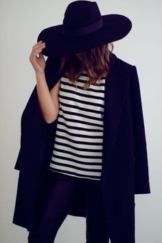 black everything + stripes + wide brimmed hat