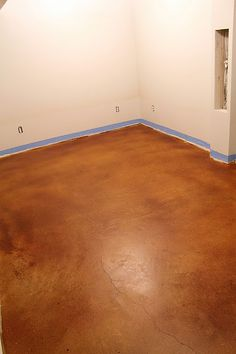 I have wanted to do this forever! Get rid of that icky carpet and stain the carpeting with a beautiful color! We wear shoes inside anyway, so why not have the beauty of stained concrete? Yes!