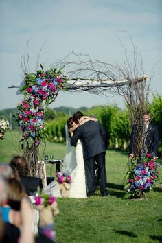 Can you tell I'm on an asymmetrical kick?  Love this blue, pink, and purple ceremony arch with roses, hydrangeas, lisianthus, and tons of curly willow.